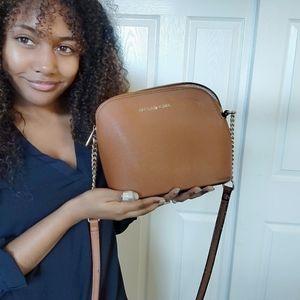 A light brown Michael kors purse